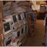 Computers sitting in an equipment warehouse