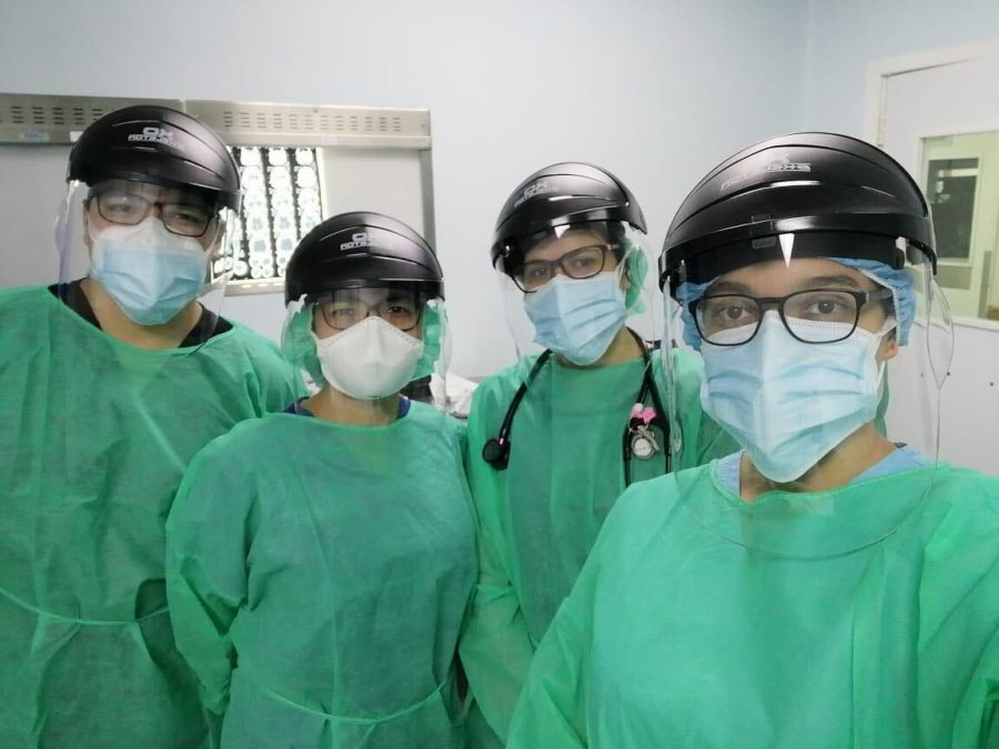 Four anesthesiologists wearing surgical masks